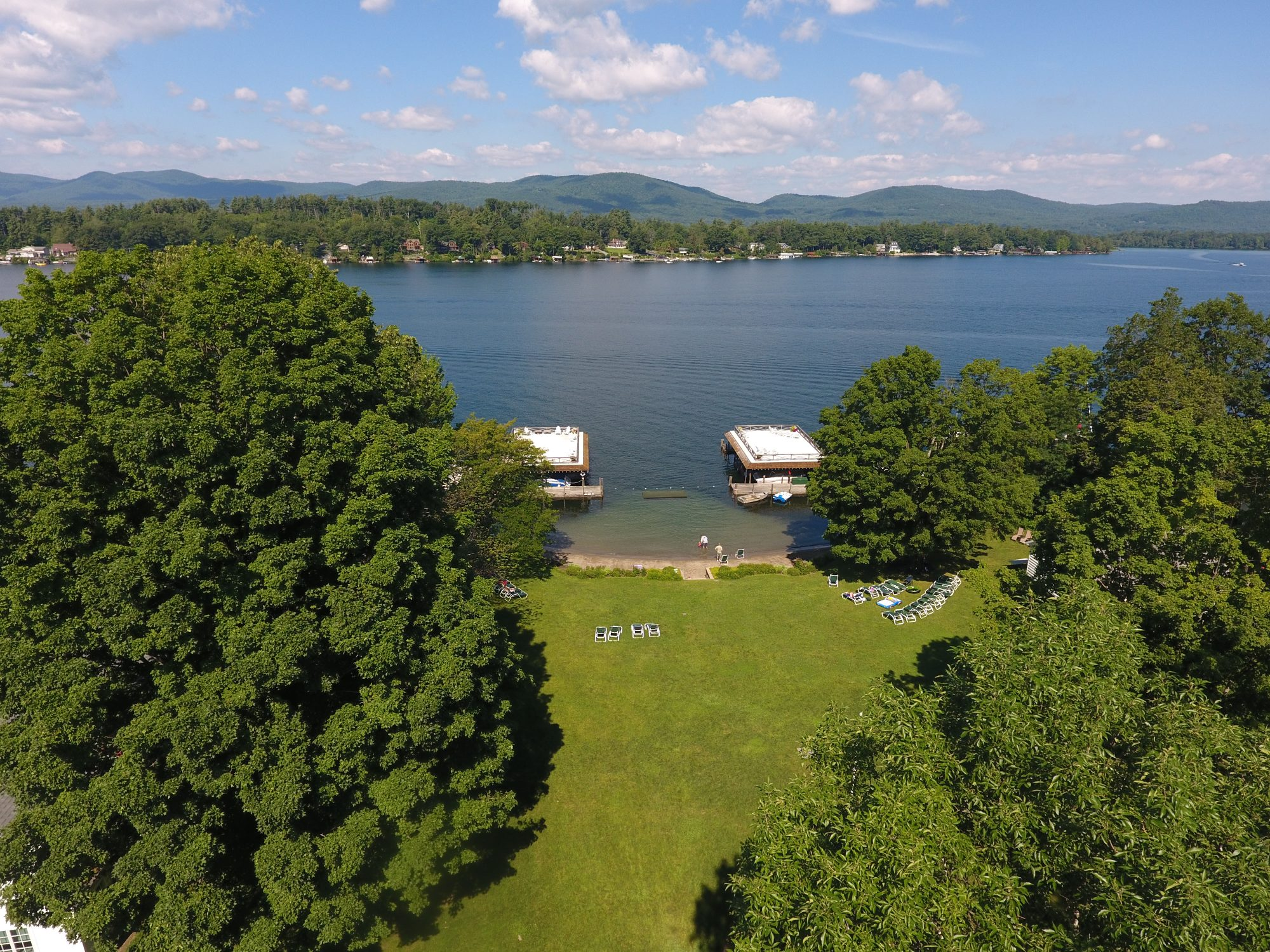 Lake George vacation cabin rental boathouse sundecks, lawns, private beach at Takundewide Cottages on Lake George