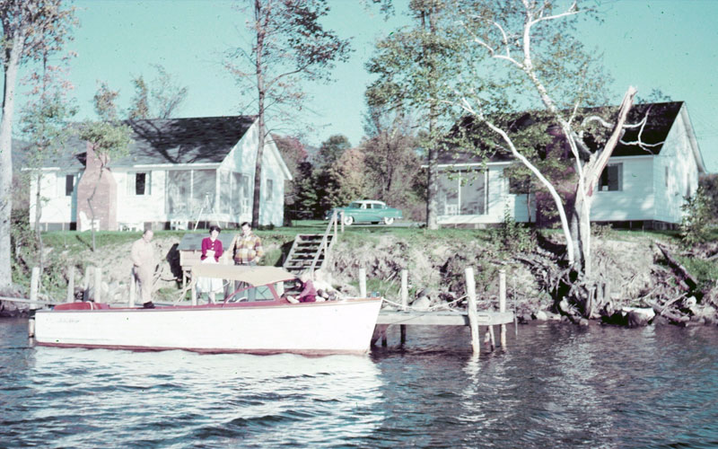 1954 picture of a boat, cottage 2 and cottage 3