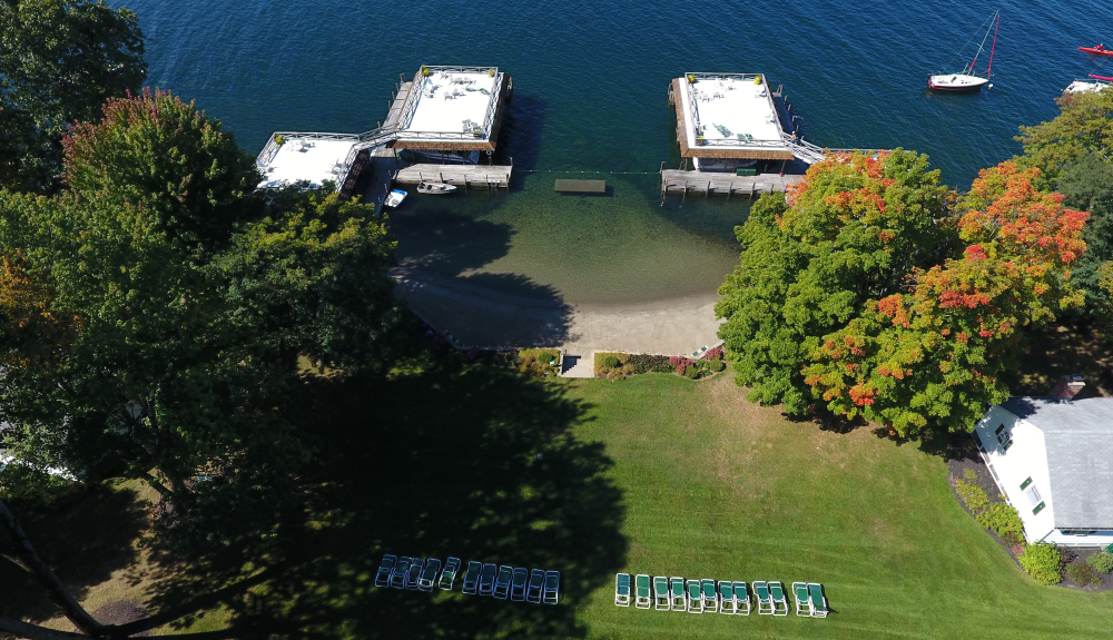 Lake George vacation rentals grounds, beach, sundecks, fall foliage at Takundewide Cottages on Lake George