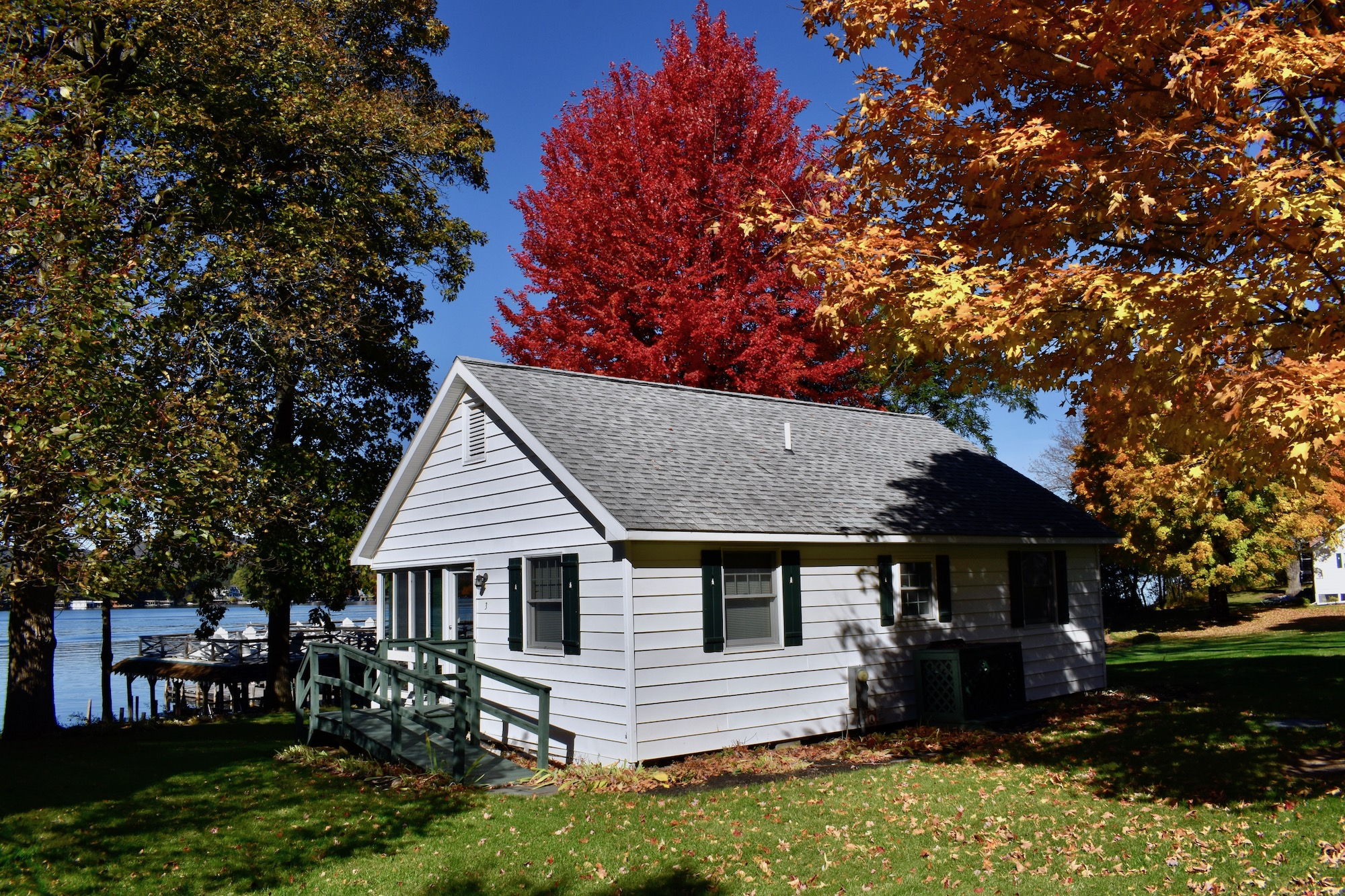 Lake George vacation cabin rental lakefront cottage with Fall Foliage at Takundewide Cottages on Lake George