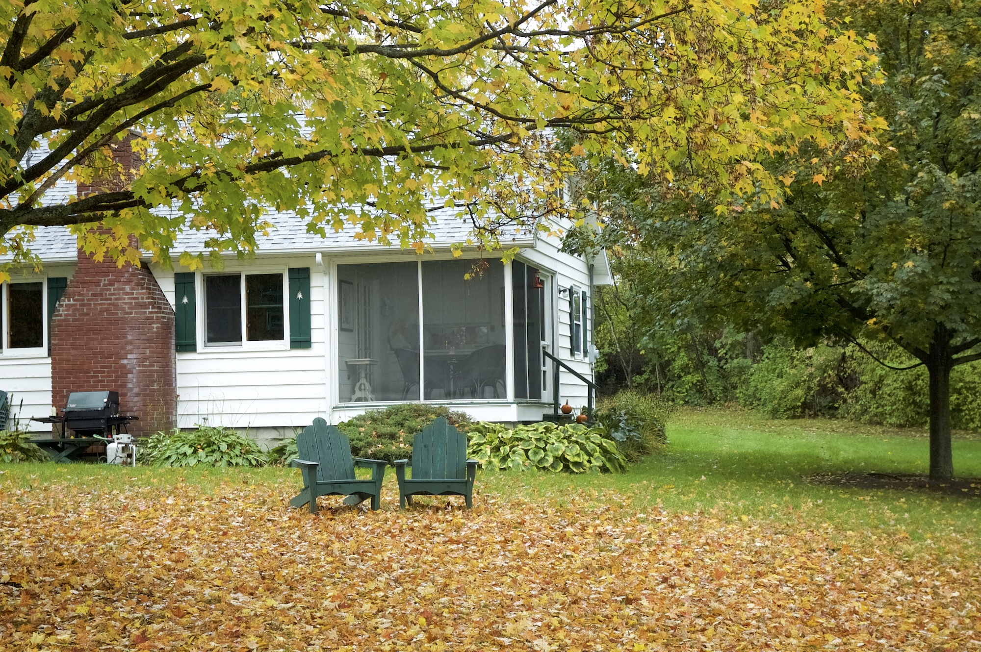 Lake George vacation cabin rental with Adirondack chairs and Fall foliage at Takundewide Cottages on Lake George