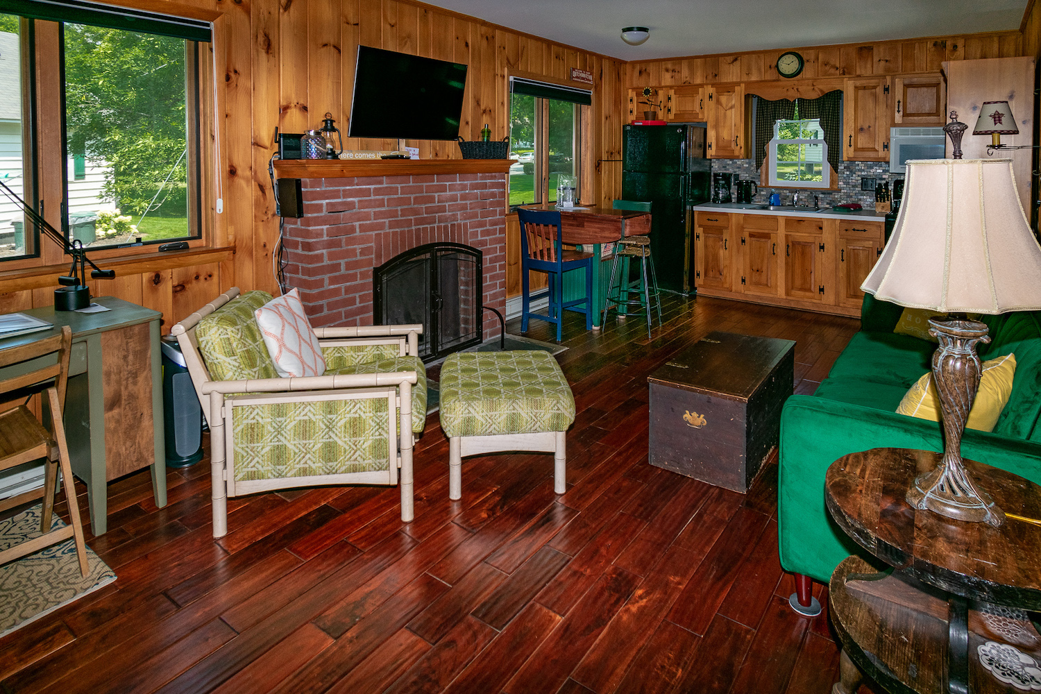 Lake George vacation cabin rental #28 knotty pine living room with brick fireplace and TV at Takundewide Cottages