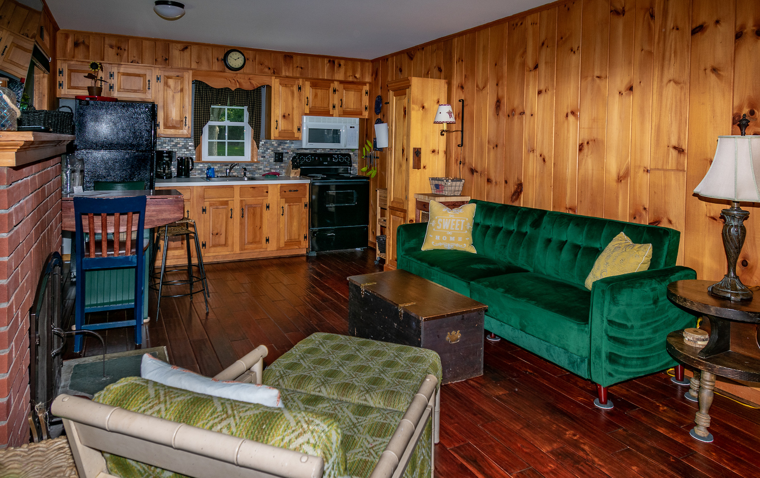 Lake George vacation cabin rental #28 knotty pine living room and kitchen at Takundewide Cottages