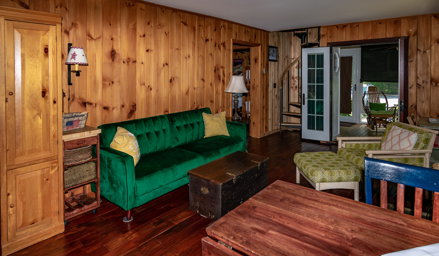 Lake George vacation cabin rental #28 knotty pine living room at Takundewide Cottages