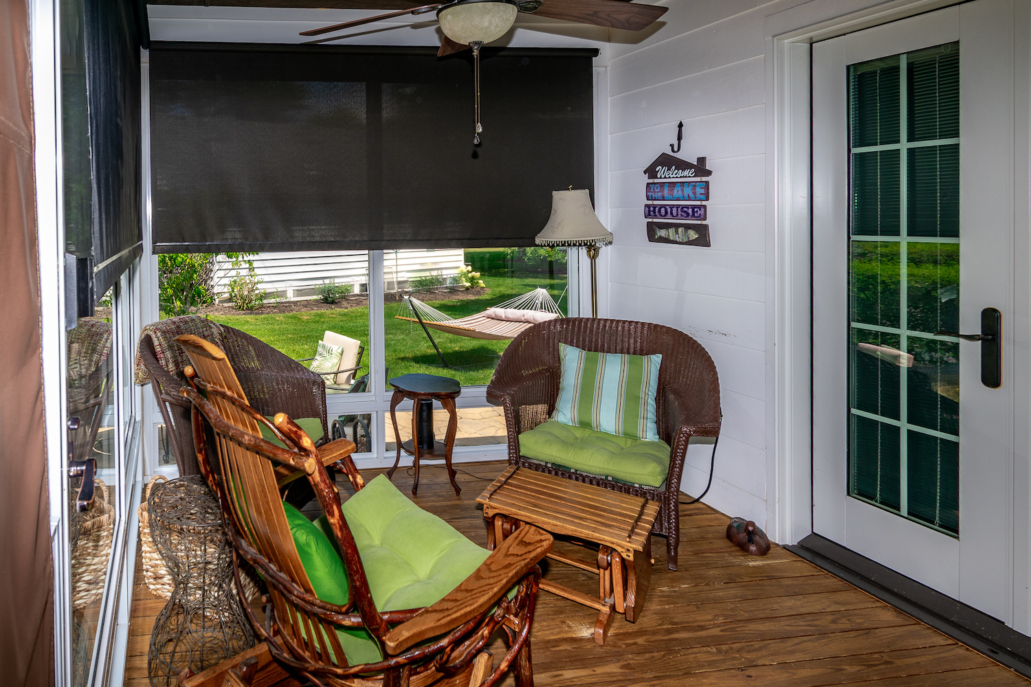 Lake George vacation cabin rental #28 porch with screen/glass enclosure and ceiling fan at Takundewide Cottages