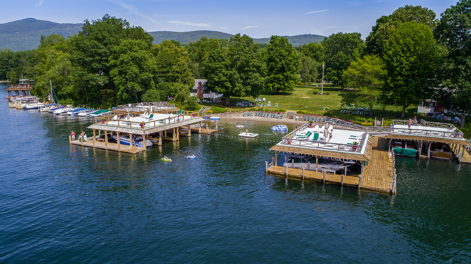 Lake George vacation cabin rental docks and beach on 700 feet of lakefront at Takundewide Cottages
