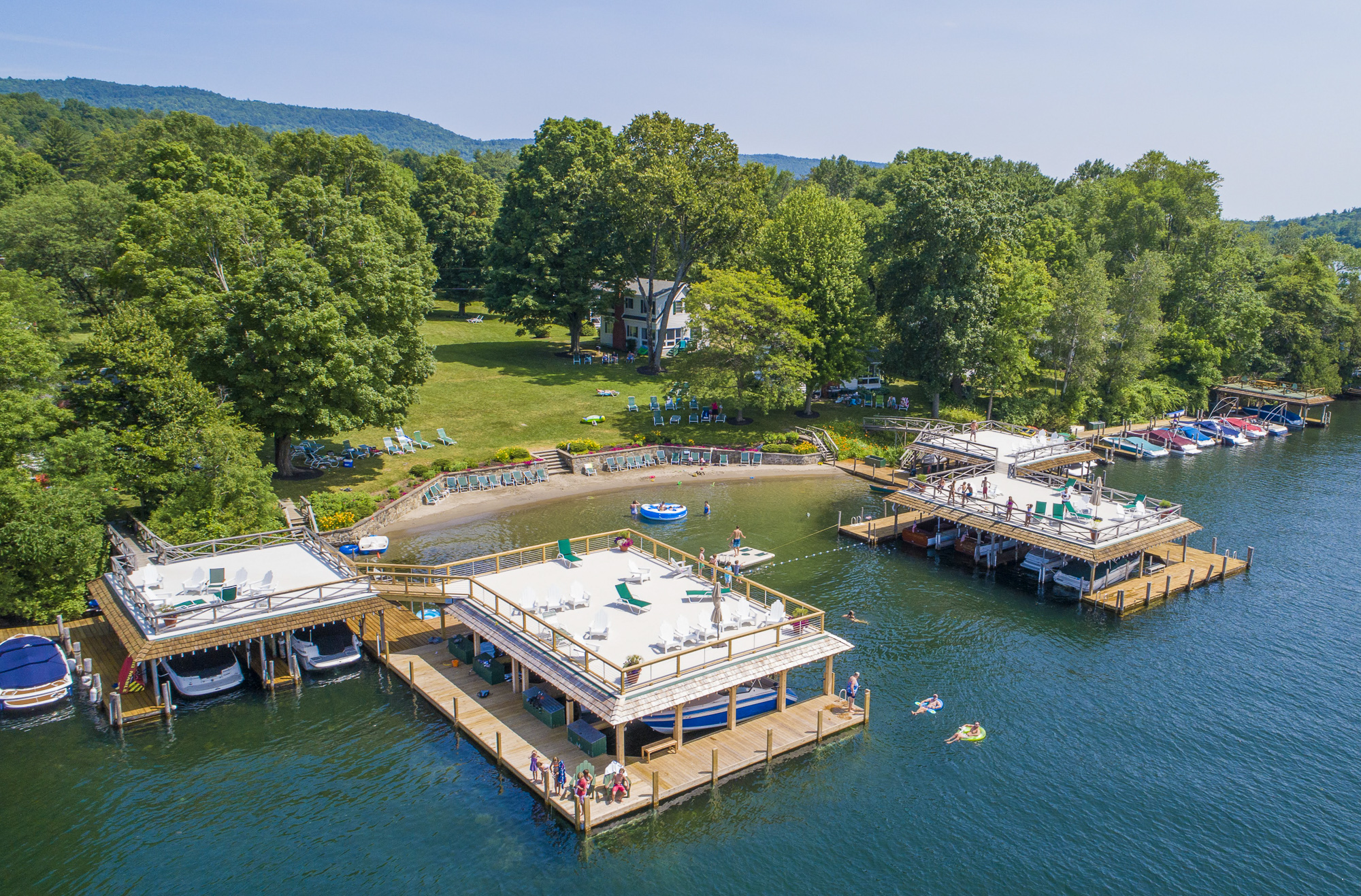 Lake George vacation cabin rentals with boathouse sundecks, private sandy beach, spacious lawns at Takundewide Cottages on Lake George