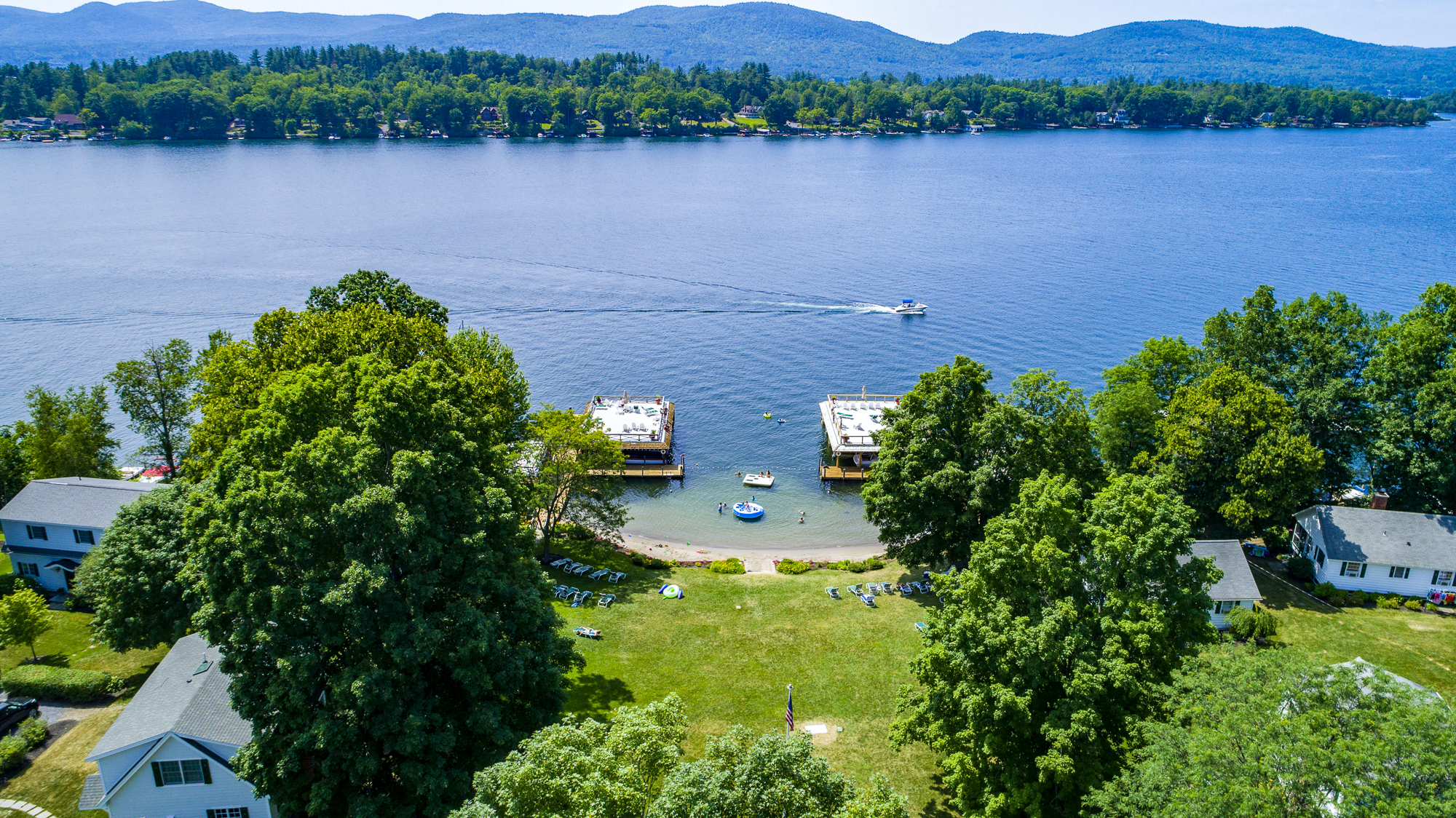 Lake George vacation cabin rentals with private beach and boathouse sundecks at Takundewide Cottages on Lake George