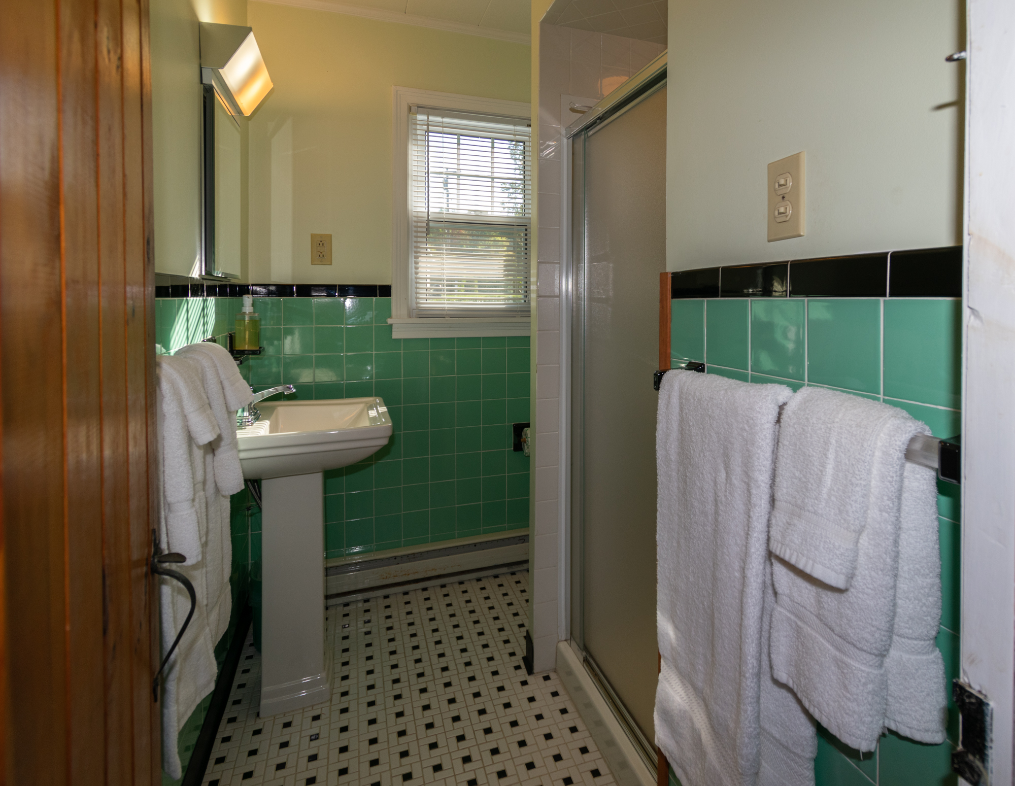Lake George grounds view vacation cabin rental #16 tiled bathroom with shower at Takundewide Cottages on Lake George