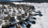 Winter aerial view of Takundewide Cottages on Lake George