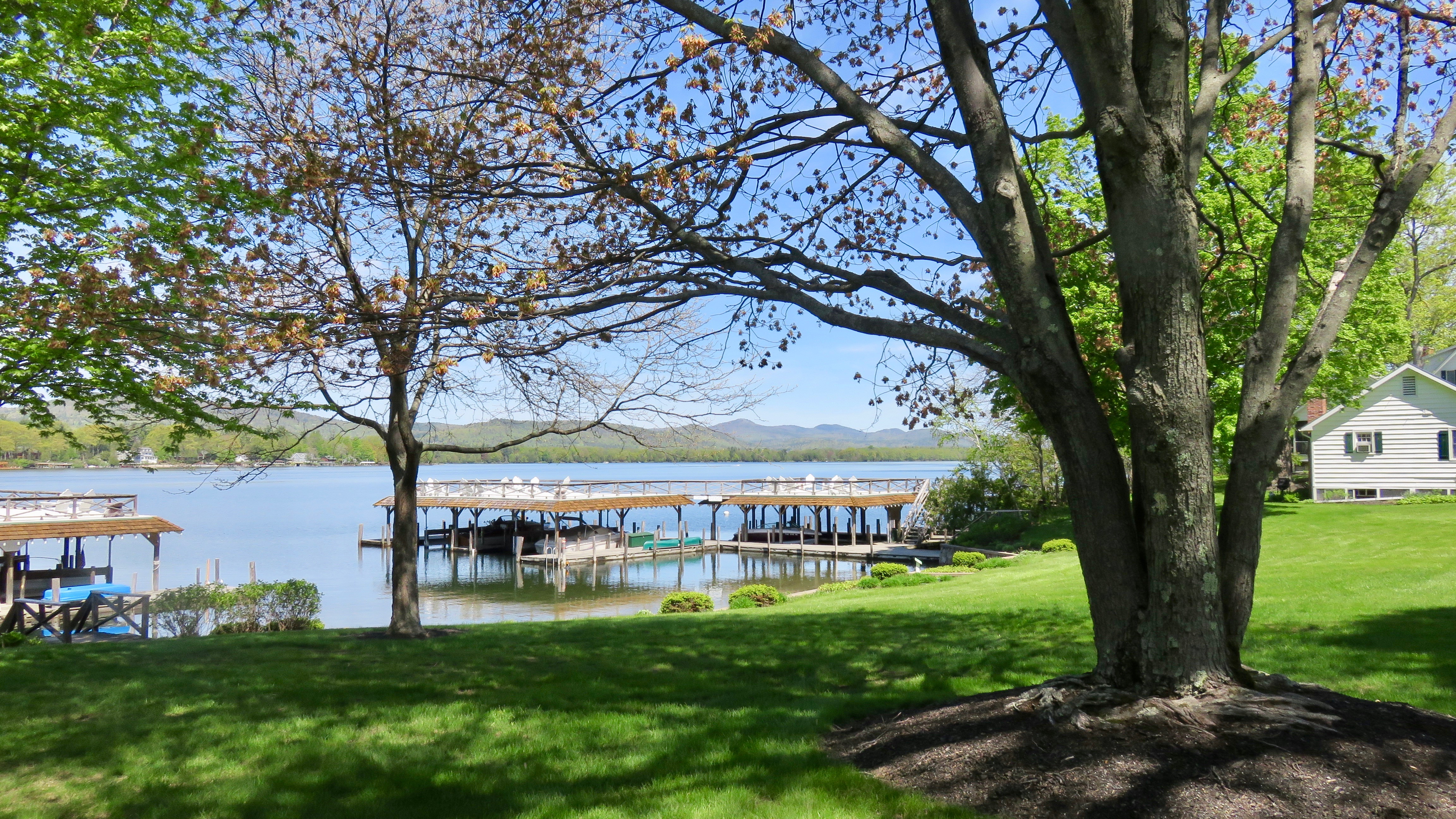 Takundewide Cottages on Lake George grounds overlooking lake in early May