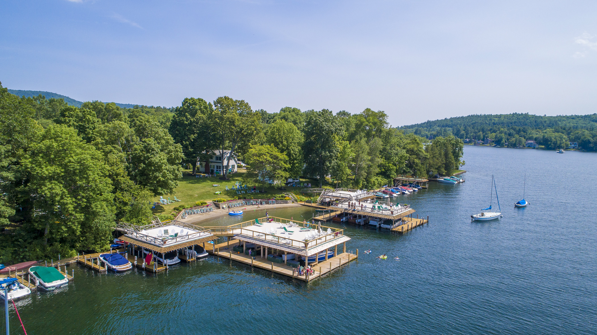 Takundewide Cottages on Lake George covered and uncovered docks and sailboat moorings